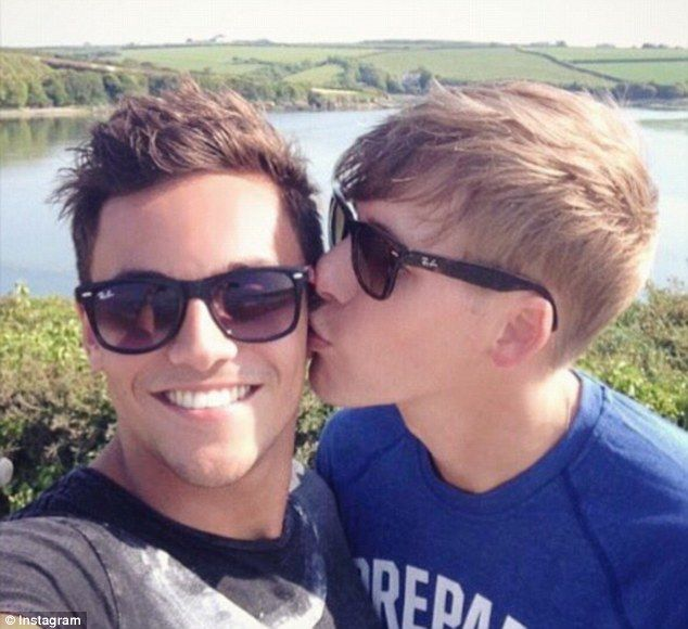 Stronger than ever: Dustin Lance Black, 42, brushed off the recent scandal surrounding his fiance Tom Daley, 22, by sharing an anniversary post about his beau on Twitter on Wednesday