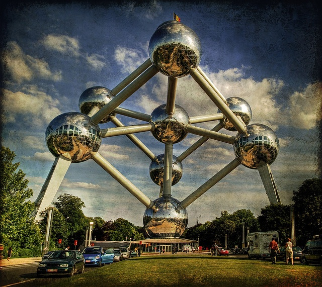 The Atomium is a monument built for Expo '58, the 1958 Brussels World's Fair.  Designed by André Waterkeyn, it is 102-metre (335-feet) tall, with nine steel spheres connected so that the whole forms the shape of a unit cell of an iron crystal magnified 165 billion times.