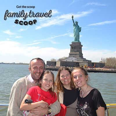 family at statue of liberty nyc