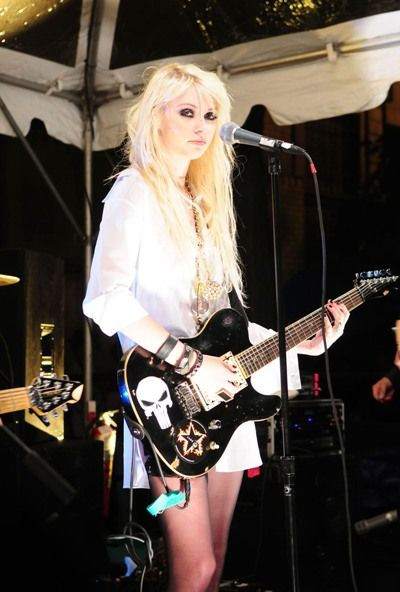 Taylor Momsen of The Pretty Reckless, even though her makeup/clothes often make her look like a grungy stripper panda. Her voice is still pretty snazzy :)