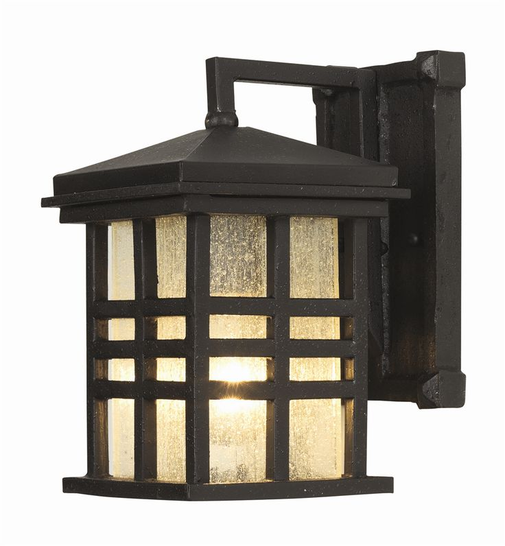 """Dimensions: Width 6"""" - Height 10"""" - Depth 8"""" Bulb Type: Medium Base Max. Bulb Wattage: 100 No. of Lights: 1 Bulbs Included: No Finish Shown: Black Glass: Seeded Description: Rustic mission style outdo"""