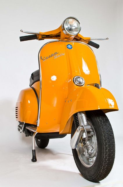 Vintage tangerine Vespa rally