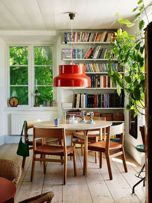 Nice combo of materials, colors, textures here. Plants and books as decoration. Your space would work better with a long table, like you have, but I look at this as inspiration for overall style.