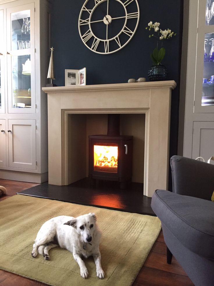 This fireplace and Contura stove were fitted in a wonderful new kitchen. This was in the 'cosy area' at the end of the room and it 'sits well' in the grade 2 listed property. If Scruffy the dog is happy, everyone's happy !