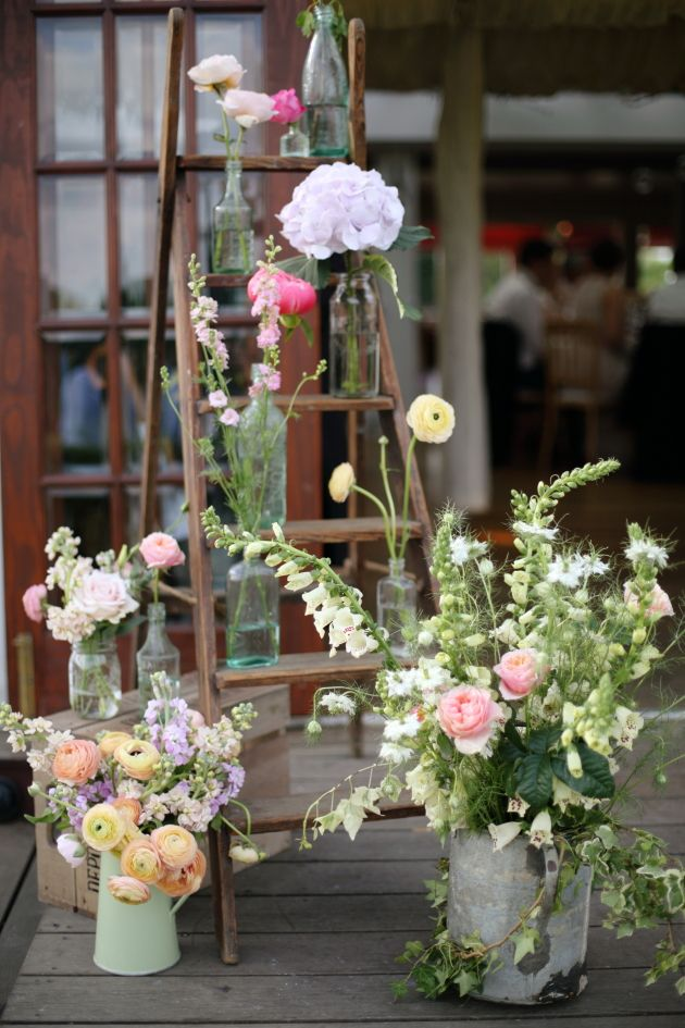 Gorgeous rustic wedding decor - ladder decorated with flowers in jars and watering cans   Dasha Caffrey Photography   see more amazing florals here: