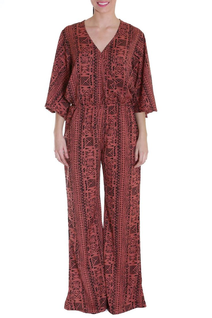 Get on trend! The Aztec Jumpsuit is your neutral standout for Spring. A wide leg and 3/4 flare sleeve allows this onesie to show your shape all while highlighting one of the hottest trends of the season. The effortless style combined with a fashionable print leaves little to be desired to adding pieces to your Spring wardrobe!   Aztec Jumpsuit by Elan USA. Clothing - Jumpsuits & Rompers - Jumpsuits New York