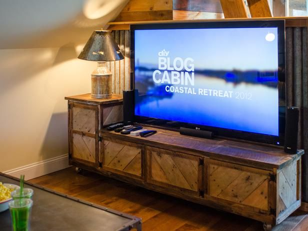 A 7-foot mobile media center, built by the Mega Dens team, incorporates reclaimed barn wood and pallet scraps.
