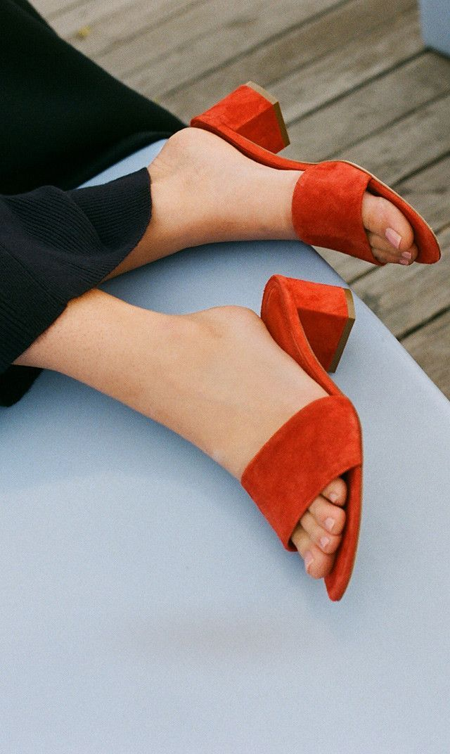 Slip on and slide into the weekend. With the temperature heating up, add a little pop of red.