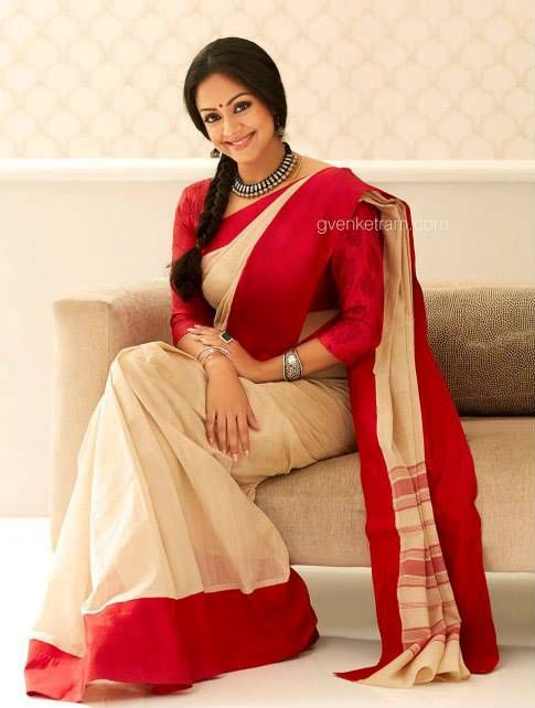 Jyothika in a beautiful Red and Cream colored saree