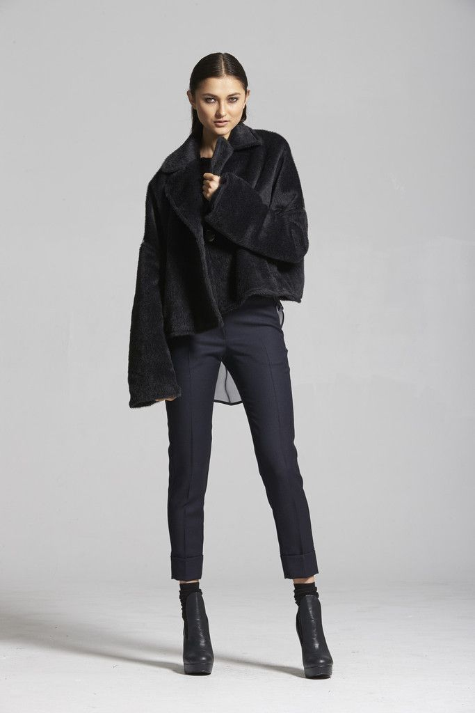 Covet Coat - Ink Melange A cropped swing coat with extra long sleeves that can be scrunched up with internal ties, the Covet Coat epitomises luxurious cool. Its relaxed structure mimics an amazingly soft and cozy sweater-like feel, but the shape remains formal enough for everyday wear.