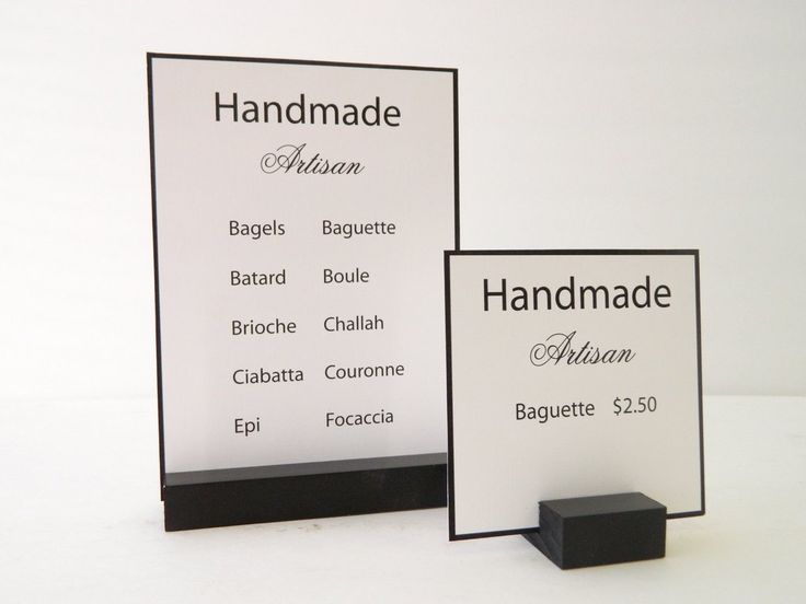 Retail & Trade Show Sign Holder in Black - 7 x 3.5 inch Dimensions: 7L x 2.5W x 3/4Tall inches Material: Wood Color: Black (please request white or stain colors) Gallery 360 Designs and manufactures s
