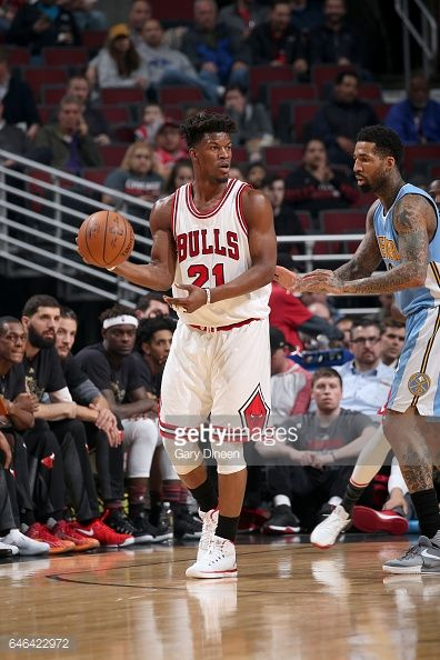 News Photo : Jimmy Butler of the Chicago Bulls passes the ball...