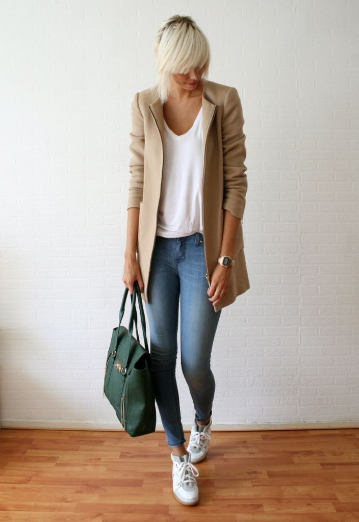 White t-shirt and jeans amped up with a neutral jacket and colorful green bag