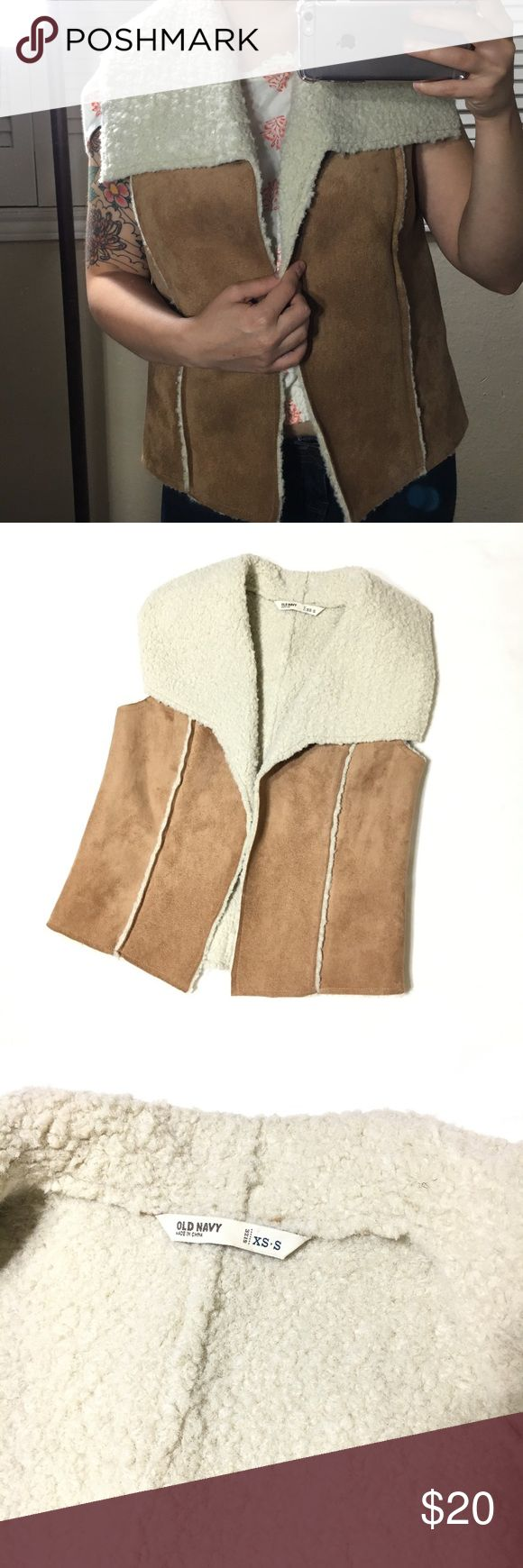 Old Navy Sherpa Vest Old Navy Sherpa Vest in size XS-S depending on how loose/fitted you want it. Gently worn with no sign of stains or rips. Old Navy Jackets & Coats Vests