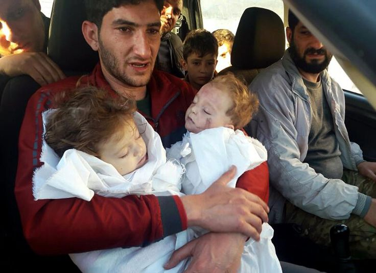 "BEIRUT (AP) — The grief-stricken father cradled his 9-month-old twins, Aya and Ahmed, each in the crook of an arm. Stroking their hair, he choked back tears, mumbling, ""Say goodbye, baby, say goodbye"" to their lifeless bodies."