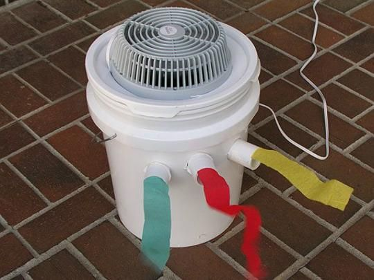 Besides an old fan and instructions, you'll need to round up a utility knife, a five-gallon bucket (with lid), Styrofoam lining, 12 inches of PVC pipe, a hole saw or Forstner bit—and a gallon jug of water to freeze for later.  First, place the fan upside down on the lid (so the airflow will be directed into the bucket), trace the outline of the fan on the lid, and cut it out with a utility knife.
