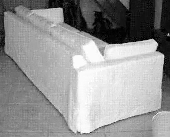 White denim slipcover back view