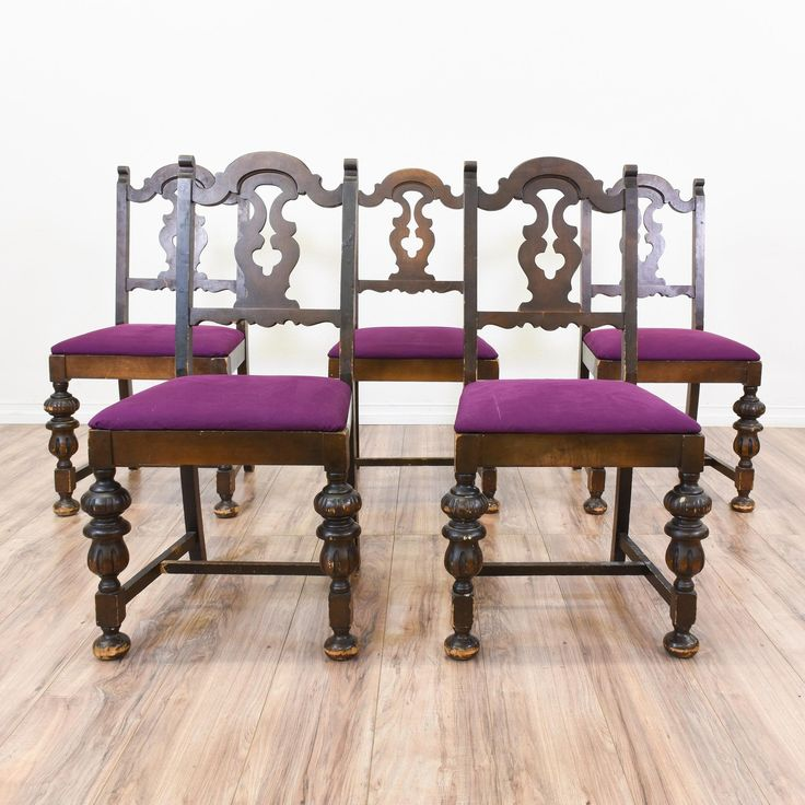 This set of 5 Spanish revival chairs are featured in a solid wood with a glossy dark walnut finish. These dining chairs are in great condition with vibrant purple upholstered seat cushions, carved curved backs and spindle legs. Eye catching chairs perfect for formal and casual dining! #mediterranean #chairs #diningchair #sandiegovintage #vintagefurniture