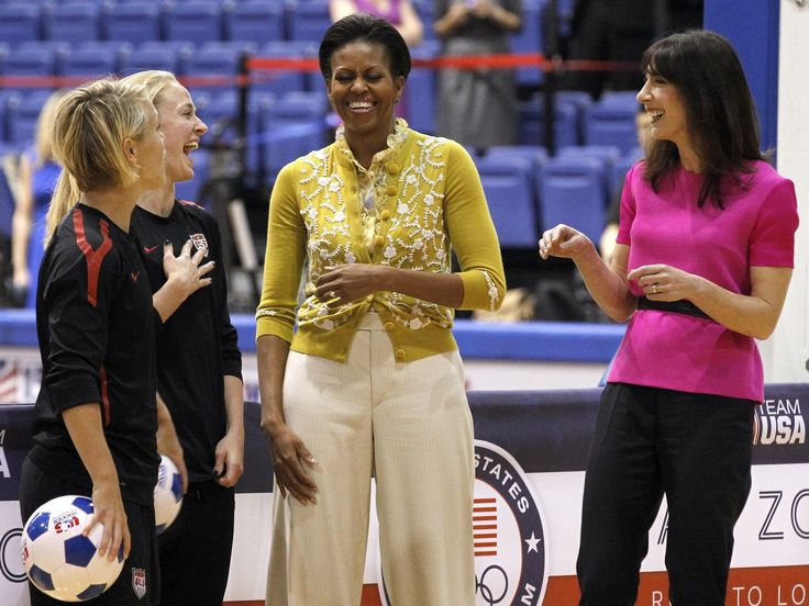 First lady Michelle Obama and Samantha Cameron, wife of British Primer Minister David Cameron, talk with United States Women's National Soccer Team midfielder Lori Ann Lindsey, left, and defender Becky Sauerbrunn as they joined with students participating in a mini-Olympics competition in celebration of the 2012 London Summer Olympics and Mrs. Obamas Lets Move! initiative, Tuesday, March 13, 2012 in Washington.