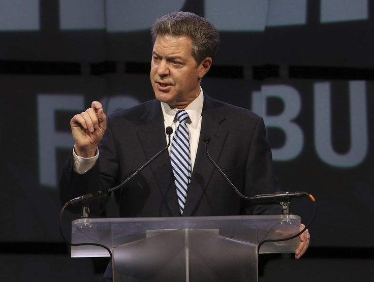 Kansas governor to veto income tax hike meant to fix budget