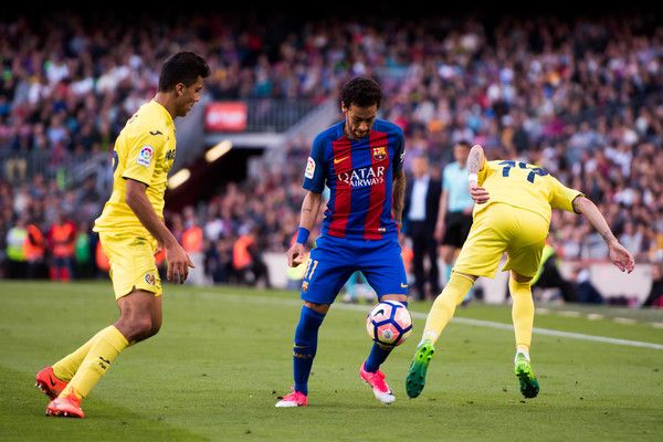Neymar Santos Jr of FC Barcelona competes for the ball with Rodrigo Hernandez (L) and Samu Castillejo (R) of Villarreal CF during the La Liga match between FC Barcelona and Villarreal CF at Camp Nou stadium on May 6, 2017 in Barcelona, Catalonia.