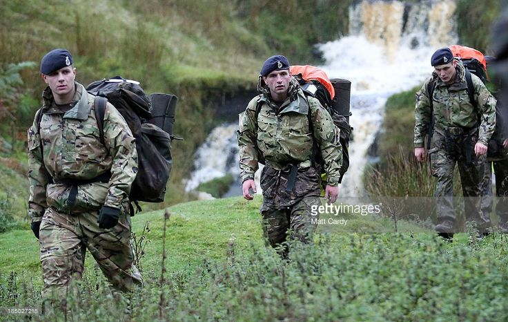 British Army officer cadets from the Royal Military Academy Sandhurst, march towards a checkpoint as they take part in Exercise Long Reach in the Brecon Beacons on October 16, 2013 near Brecon, Wales. The 36-hour, 50-mile march with kit, involves 200 cadets, six weeks into junior term of their year-long course, being also made to conduct a number of command tasks, testing not only their physical endurance but also their mental ability when tired and under pressure. As a result, the exercise…