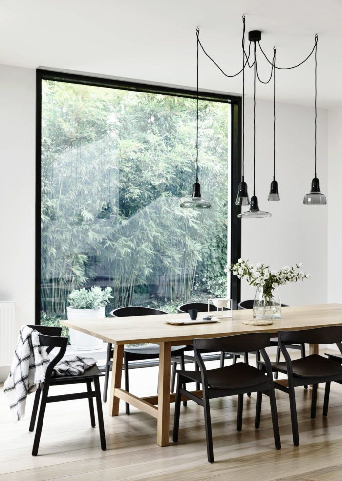 This is the kind of window I would love to have in my dining room. It would be amazing to have this much natural light and a beautiful green view of the plants in the garden.