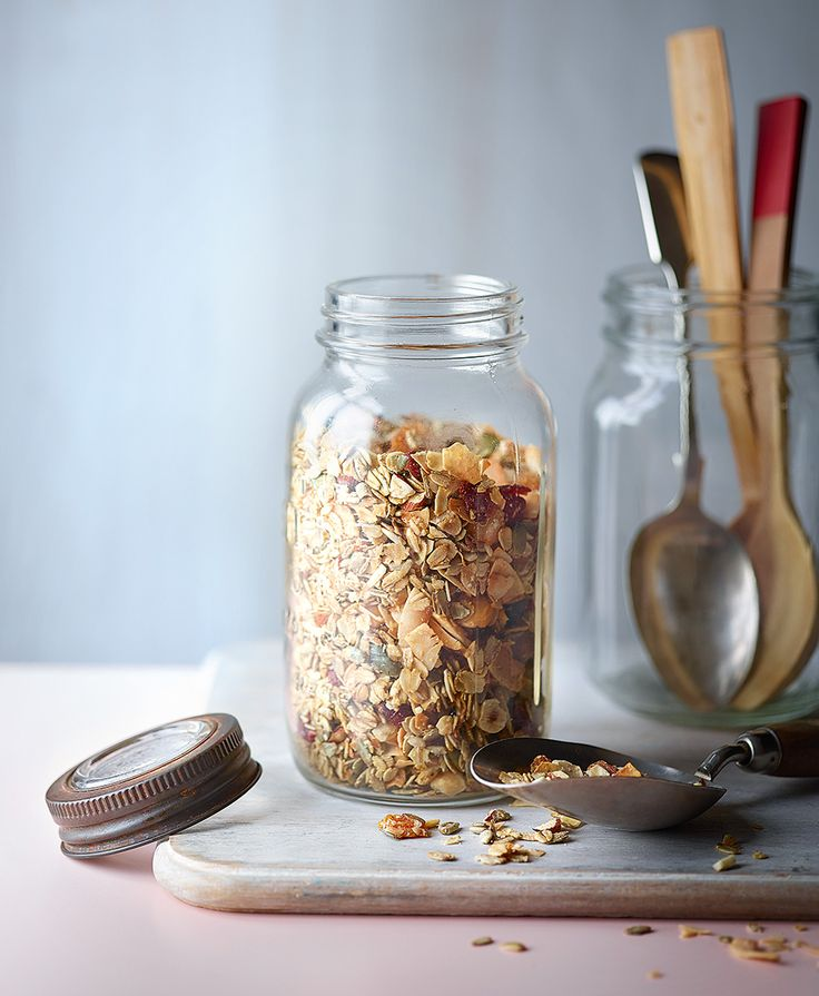 While most shop-bought granolas are alarmingly high in sugar, our low-sugar granola recipe is made with lower in sugar and made with coconut oil, coconut flakes, mixed fruits, nuts and seeds.