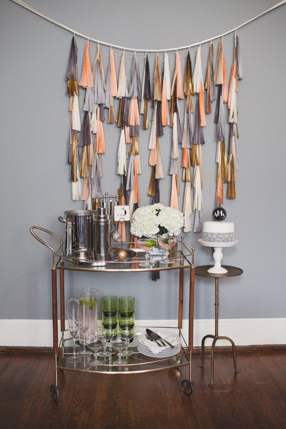 Hey, I found this really awesome Etsy listing at http://www.etsy.com/listing/155552541/art-deco-tassel-backdrop-peaches-n-cream