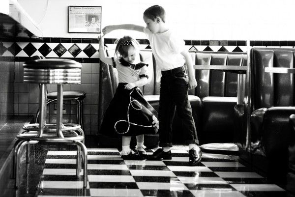Kids twirling in a diner