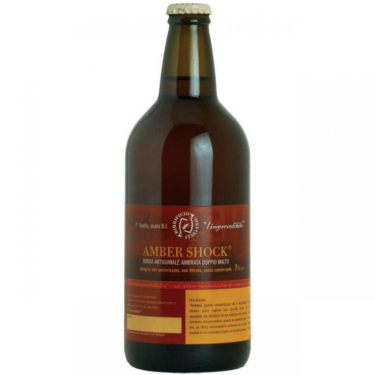Birra di colore ambrato carico con schiuma brunastra, compatta e persistente…