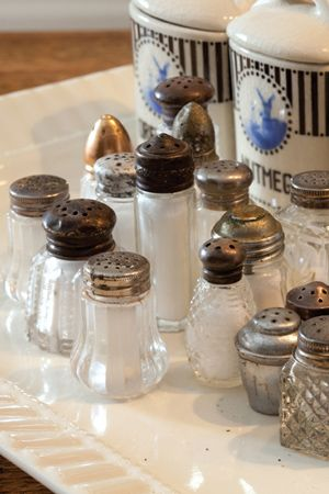 Mismatched vintage miniature salt & pepper shakers are inexpensive & add retro appeal to a tablescape.
