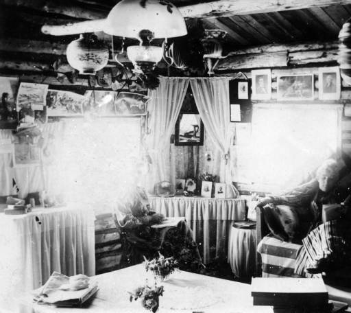 Probably Elizabeth Byers in the W.F. and Mary Byers Robinson cabin in Ferndale, CO circa 1890-1900.  From the Denver Library Western History Collection.