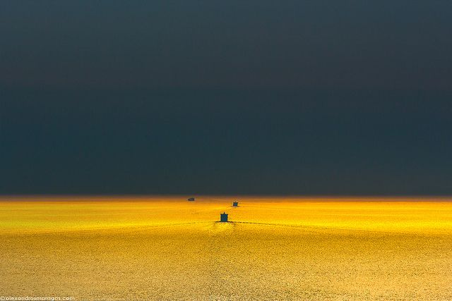 Ships leaving at sunset- Pure as Gold - photo by Alexandros Maragos