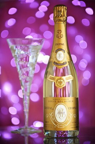Cristal Champagne. Originally made exclusively for a Csar of Russia, it is now the preferred Hollywood drink.
