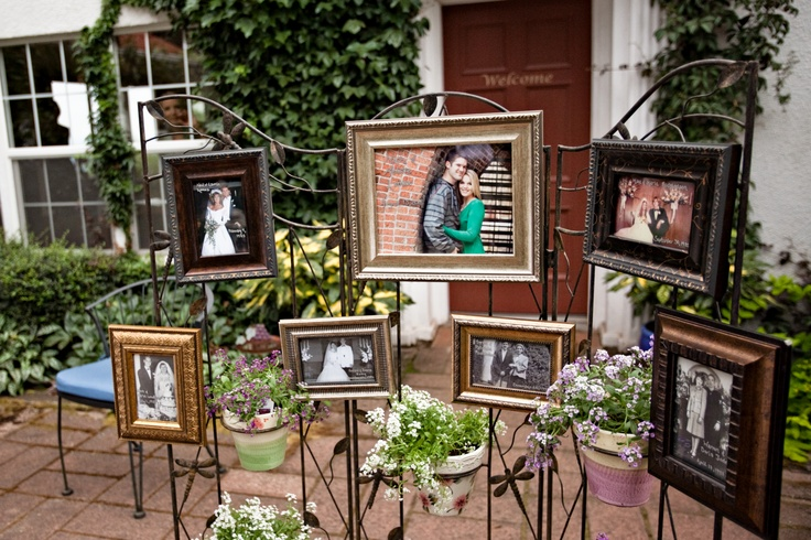 This couple set up their parents and grandparents wedding photos, along with their favorite engagement photo by the wish jar.
