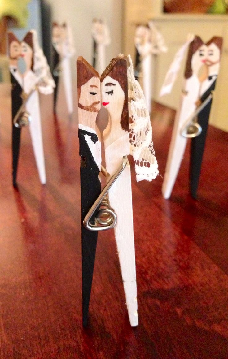Kissing clothespin wedding couples for the centerpieces at my cousin's rehearsal dinner. Based on Jessie Jane's kissing clothespin couples on Lilyshop.com.