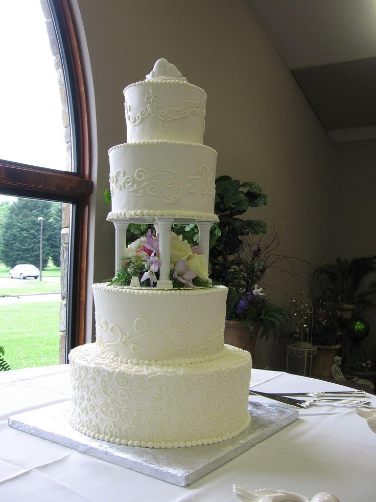 4 Tier Buttercream Wedding Cake W Pillars With Simple