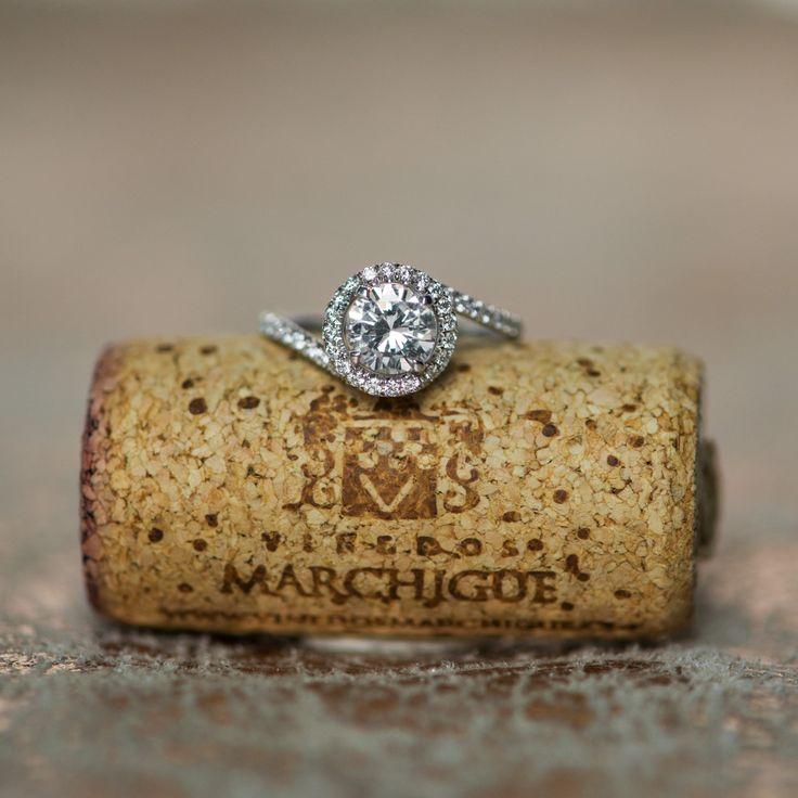 This is such a unique take on the popular halo engagement ring style, and we're loving it.