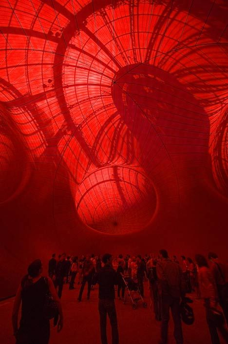 Leviathan by Anish Kapoor - a series of giant interconnected womb-like orbs in the Grand Palais, Paris.