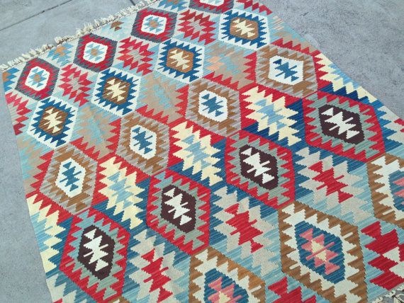 It was $610. NOW, ONLY $508!!! Handwoven kilim/rug with strong tribal patterns and soft pastel/faded colors. 100% natural wool, natural dyes! Beautiful.. ♦ place of origin: Central part of Turkey ♦ age: 65 years old ♦ materials used: 100% natural wool ♦ weaving technique used: Flat woven Condition: Very nice! All our rugs and pillows have been professionally cleaned and ready to use. Dry Clean Only Approx. measurements: 53 x 71 not including fringe Ways to use: Living room Dini...
