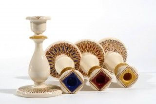 <h3>Elegant and refined, the <strong>Spicchi candlesticks are authentic works of Italian ceramic art</strong>.</h3><br /> <p>They are handmade by <a title='Francesco Fasano Italian pottery ceramics' href='http://www.thatsarte.com/handmade-italian/artist/francesco_fasano'>Francesco Fasano, a most celebrated ceramic artists in Grottaglie</a>. He is known for his unique style that combines <strong>a precious design and a perfect technical execution</strong>. Made using a proprietary process…
