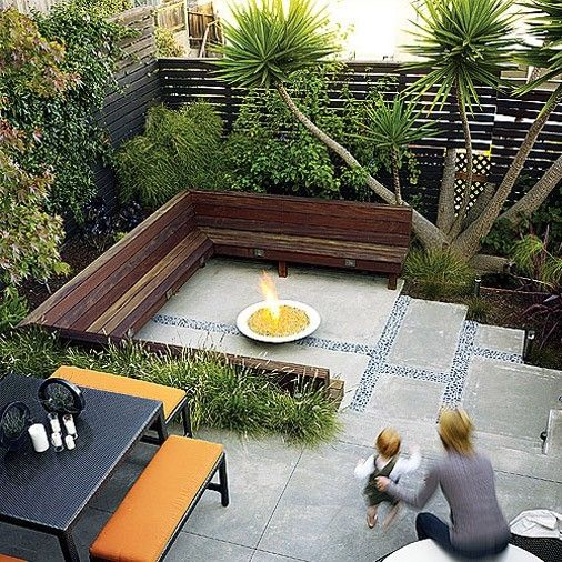 Back patio-greenery along perimeter, bench, pavers in center