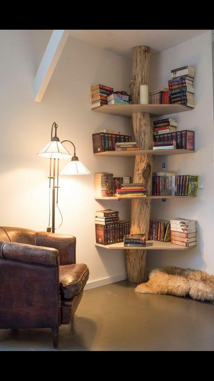 DYI bookshelf teamed with floor lamp and leather armchair.
