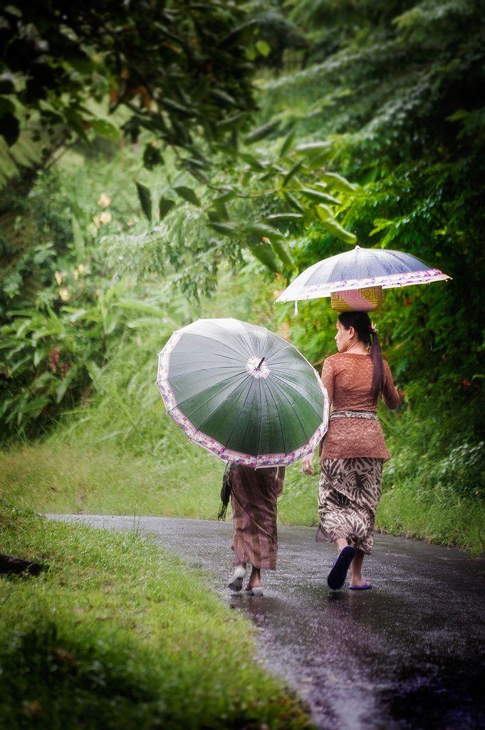 Walk in the rain . Bali Indonesia