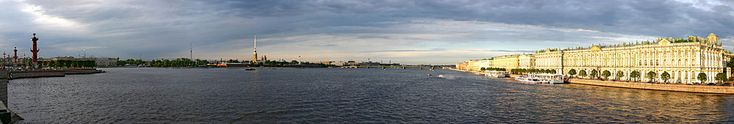 The River Neva flowing through St. Petersburg--Peter and Paul Fortress center, Winter Palace on the right.