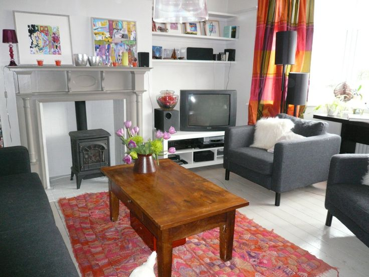 A front room combining period features and a pop art style