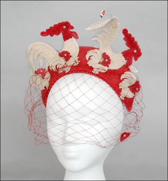 Bes-Ben white 'Rooster' hat | United States, ca. 1968 | Red straw cap with raised crown edged with red beads | On the front are mounted two large embroidered roosters with red heads and white bodies. In the front of them are four small red and white roosters. From the tail of one of the large roosters flies a lady bug | Red veil