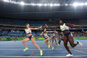 Britain's Kelly Massey grabs the baton from Anyika Onuora.