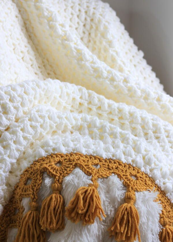 many colors Hand knit baby blanket in diamond pattern with crocheted border made to order
